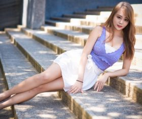 Lie on ones side beautiful woman on the steps Stock Photo