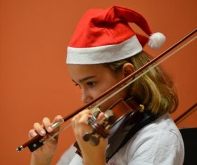Little girl playing the violin Stock Photo