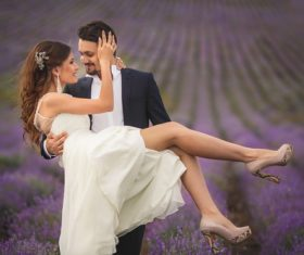 Outdoor lavender flower field wedding photo