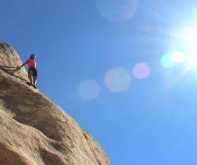 People are rock climbing Stock Photo 04