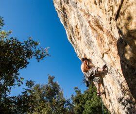 People are rock climbing Stock Photo 09