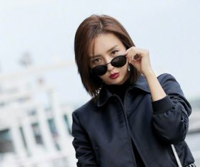 Pretty woman taking off sunglasses Stock Photo