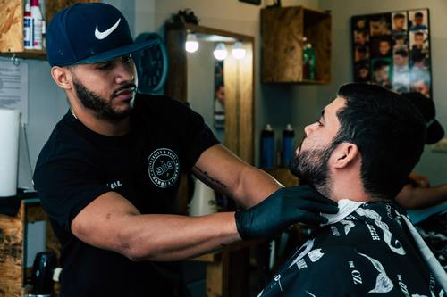 Professional barber shaves the customer Stock Photo 02