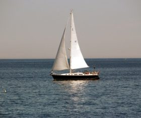 Small sailing boat at sea Stock Photo 04