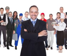 Smiling businessman and people of different professions Stock Photo