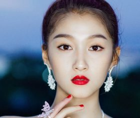Stock Photo Asian girl wearing jewelry earrings