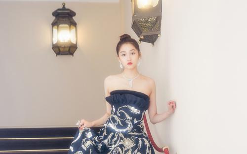 Stock Photo Beautiful Chinese girl in black gold long dress