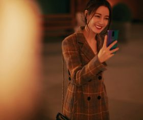 Stock Photo Beautiful girl holding a mobile phone selfie