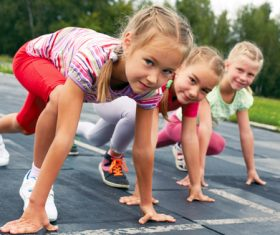 Stock Photo Little girls preparing for running competition