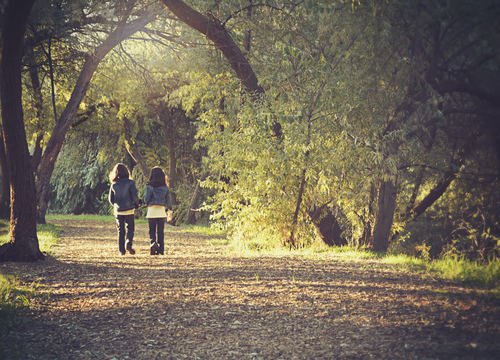 Stock Photo Little sisters walking in the park