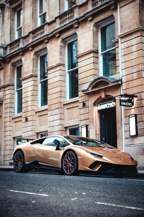 Stock Photo Luxury sports car parked in front of the apartment