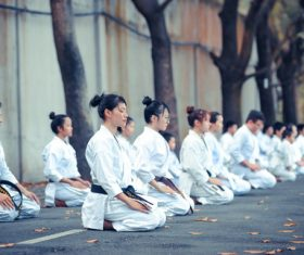 Stock Photo People knelt meditation