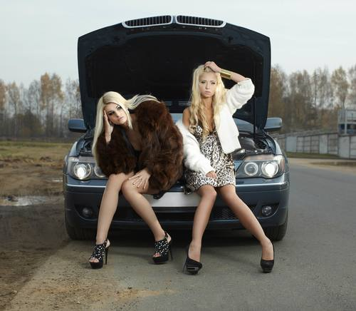 Stock Photo Two beautiful girls with sports car