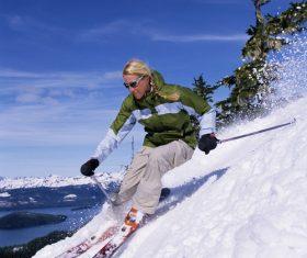 Stock Photo Woman alpine skiing
