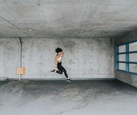 Stock Photo Woman jumping in the room