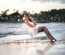 Stock Photo Woman levitation on the beach