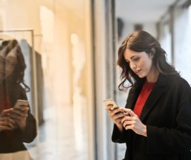 Stock Photo Woman looking at cell phone 01