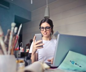 Stock Photo Woman looking at cell phone 03