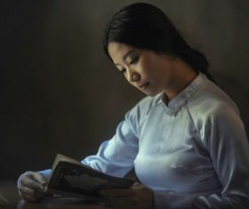 Stock Photo Woman reading a book