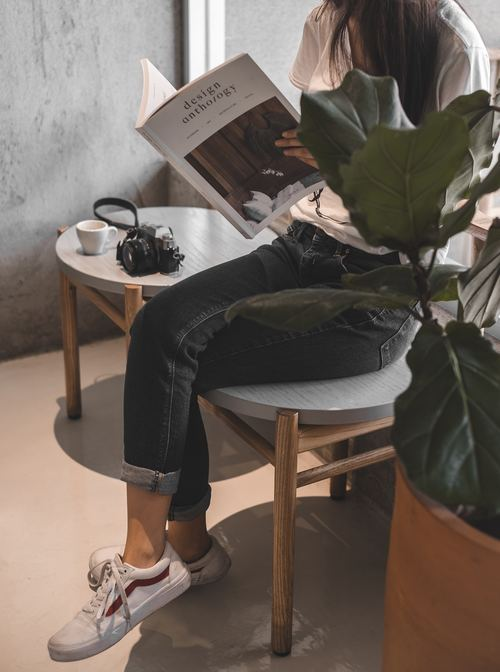 Stock Photo Woman resting and reading magazine