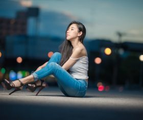 Stock Photo Woman under the street lamp