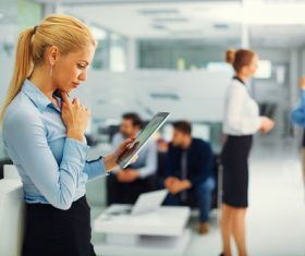Stock Photo Woman using tablet in company