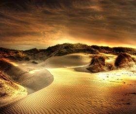 The afterglow of the sunset shines on the sand dunes Stock Photo