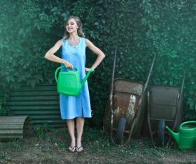 Woman holding a watering can Stock Photo