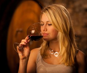 Woman tasting wine Stock Photo 01