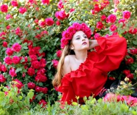 Woman with a wreath of roses on the head Stock Photo 01