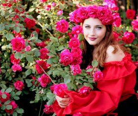 Woman with a wreath of roses on the head Stock Photo 03