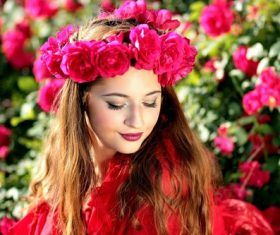 Woman with a wreath of roses on the head Stock Photo 04