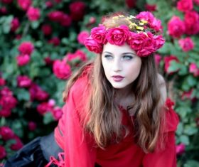 Woman with a wreath of roses on the head Stock Photo 05