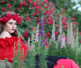 Woman with a wreath of roses on the head Stock Photo 06
