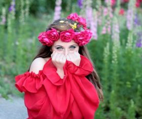 Woman with a wreath of roses on the head Stock Photo 07