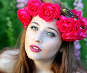 Woman with a wreath of roses on the head Stock Photo 09