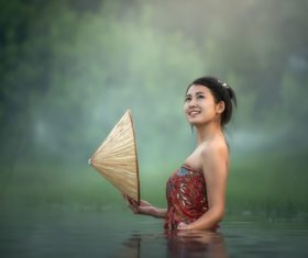 Young beautiful Cambodian girl in the water Stock Photo