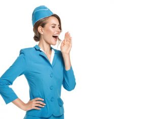 Young beautiful airplane stewardess Stock Photo 01