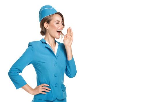 Young beautiful airplane stewardess Stock Photo 01