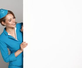 Young beautiful airplane stewardess Stock Photo 02