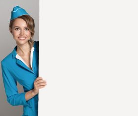 Young beautiful airplane stewardess Stock Photo 03