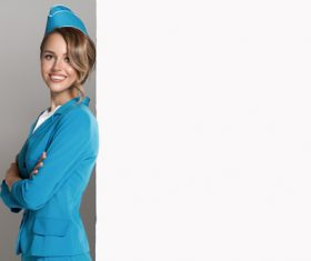 Young beautiful airplane stewardess Stock Photo 04