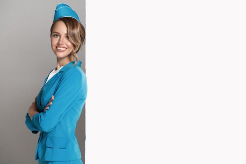 Young beautiful airplane stewardess Stock Photo 04