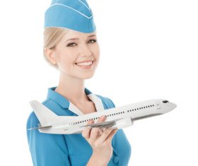 Young beautiful airplane stewardess Stock Photo 07