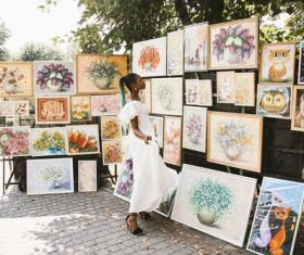 Black beautiful girl looking at art exhibition Stock Photo