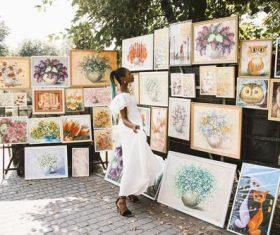 Black beautiful girl looking at art exhibition Stock Photo