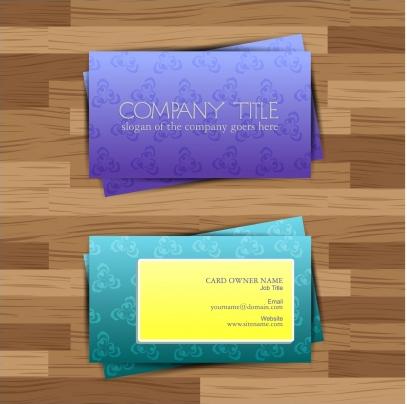 Business card on wood floor Free vector