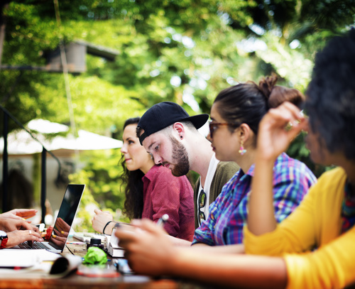 College students who are gathered together to study Stock Photo