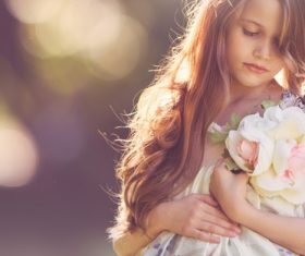 Cute little girl holding bouquet Stock Photo