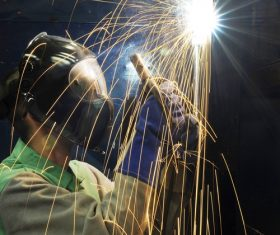 Electric welder working Stock Photo 01